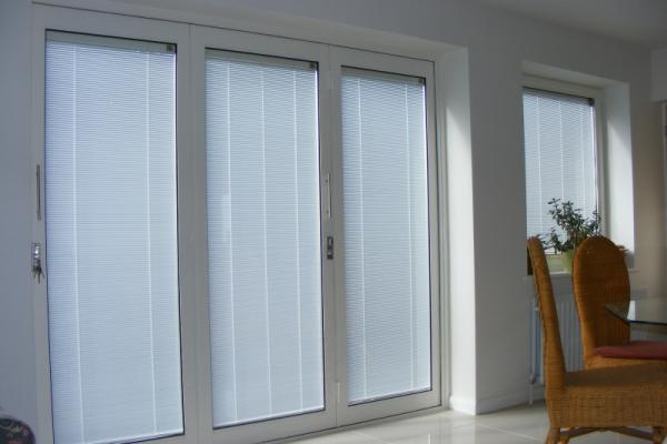 bi fold doors with enclosed blinds